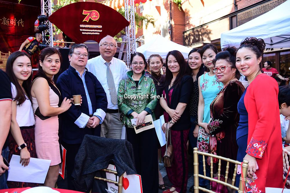 黄萍 (Ping Huang)is a General Secretary of London Chinatown Chinese Association in green dress and her community of Zhejiang UK Association attend the Moon festival - The big feast for the chinese community and the 70th Anniversary of China at Chinatown Square on the 15th September 2019, London, UK.