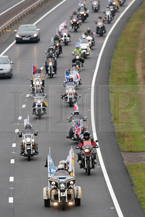 """© Licensed to London News Pictures. 3/10/2015, Tamworth, Staffordshire, UK. The eighth Ride to the Wall """"RTTW"""" took place today with thousands of motorcyclists arriving at the National Memorial Arboretum. Starting at eleven designated points around the country, the riders came from all over the UK as well as continental Europe.They rode to visit the walls of the Armed Forces Memorial where the names of 16,000 service men and women are engraved to remember those killed on duty or by terrorist action since the end of the Second World War. A display by the white helmets, tiger moth flypast and memorial service formed part of the day. Pictured, riders make their way along the A5 through Tamworth towards the NMA. Photo credit / Dave Warren/LNP"""