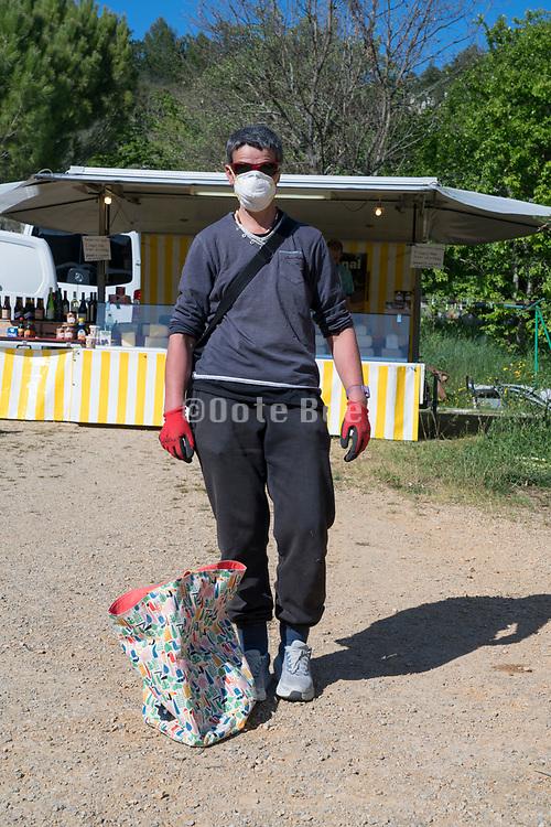 outdoors food market shopper portrait during Covid 19 crisis France Limoux April 2020
