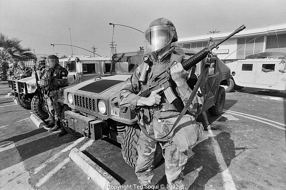 National Guard soldiers armed with machine guns and grenade launchers, hold a line on Crenshaw blvd. in South Central L.A.
