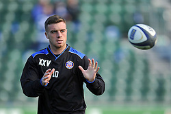 George Ford of Bath Rugby receives the ball during the pre-match warm-up - Photo mandatory by-line: Patrick Khachfe/JMP - Mobile: 07966 386802 25/10/2014 - SPORT - RUGBY UNION - Bath - The Recreation Ground - Bath Rugby v Toulouse - European Rugby Champions Cup