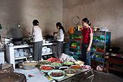 Small roadside restaurant kitchen near to Lugu Lake, Yunnan, China. Staff have prepared the chopped vegetables ready to cook.