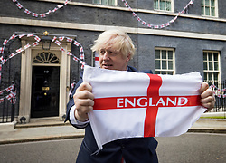© Licensed to London News Pictures. 09/07/2021. London, UK. British Prime Minster BORIS JOHNSON is seen taking part in a stunt outside number 10 Downing Street, ahead of the Euro 2020 Championship final between England and Italy on Sunday.. Photo credit: Ben Cawthra/LNP