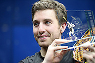 Mathieu Castagnet of France  lifts the Canary Wharf Classic Trophy after winning the final. the Final, Omar Mosaad of Egypt v Mathieu Castagnet of France , Canary Wharf Squash Classic 2016 , at the East Wintergarden in Canary Wharf , London on Friday 11th March 2016.<br /> pic by John Patrick Fletcher, Andrew Orchard sports photography.