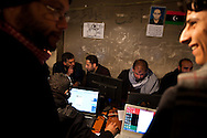 Protesters work in a media center in Benghazi where they produce videos, infomation, music, graphic design and a newspaper about the revolution to dessiminate on the internet and in Libya on March 1, 2011.