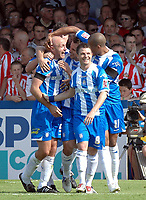 Photo: Ashley Pickering.<br /> Colchester United v Sunderland. Coca Cola Championship. 21/04/2007.<br /> Wayne Brown (L) is congratulated by team mates after he scores the opening goal for Colchester
