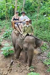 Eva & Bill Riding An Elephant