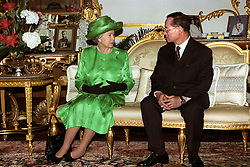 File photo dated 28/10/96 of Queen Elizabeth II with King Bhumibol Adulyadej of Thailand following her arrival in Bangkok, as the Queen has become the world's longest reigning living monarch following his death.