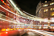 Light trails at Oxford Circus in London, with Christmas lights