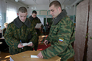 Sosyenki, Moscow Region, Russia, 14/03/2004..Soldiers voting in a wooden school house used as a polling staion for the Russian Presidential election.
