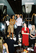 Yasmin Mills, Peter Tong and Paula Reed. Gilda's Club party. Isola. London. 5/2/01 © Copyright Photograph by Dafydd Jones 66 Stockwell Park Rd. London SW9 0DA Tel 020 7733 0108 www.dafjones.com