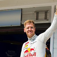 Red Bull F1 Formula One driver Sebastian Vettel of Germany waves celebrating his second place after the qualifier of the Hungarian F1 Grand Prix in Mogyorod (about 20km north-east from capital city Budapest), Hungary on July 27, 2013. ATTILA VOLGYI