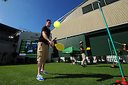 SKY City Breakers corporate sales manager Dillion Boucher and Thomas Abercrombie at the Heineken Lounge playing swing tennis during the Heineken Open Day 2. ASB Tennis Centre, Auckland, New Zealand. Tuesday 7 January 2014. Photo: Chris Symes/www.photosport.co.nz
