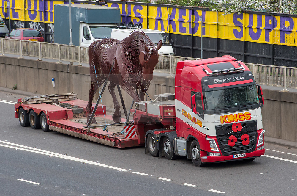 """© Licensed to London News Pictures. 23/04/2018. Bristol, UK. A five metre tall steel """"Warhorse"""" sculpture leaves Bristol for a trip of 196 miles by road to West Yorkshire to be part of a war memorial. The horse has been crafted by Bristol sculpture company Codsteaks and weighs about two tonnes. The war memorial is heading to Featherstone to coincide with the 100th anniversary of the end of World War I. Photo credit: Simon Chapman/LNP"""