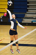 Milpitas senior Melissa Story (13) spikes the ball against Monta Vista High School on Sept. 10, 2012.  Milpitas would go on to lose in 4 sets, 7-25, 16-25, INSERT SCORE, 17-25.  Photo by Stan Olszewski/SOSKIphoto.
