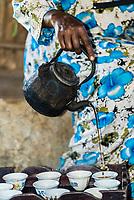 Woman pouring coffee, Blue Nile Falls (Tis Abay), Ethiopia.