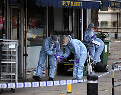 © London News Pictures. 01/11/2013. London, UK. Forensics at the scene of the shooting of two shop workers at Show Supermarket in High Street, Plaistow, London. One man in his 50s is in a critical condition and the other in his 40s is in a stable condition in hospital. Photo credit: LNP