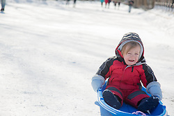 baby crying as he goes sledding for the first time in New York City
