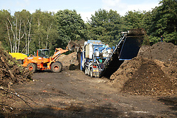 Green Waste being shredded to mulch,