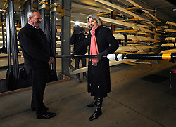 © Licensed to London News Pictures. 27/02/2012, London, UK. (L-R ) IVOR LLOYD Managing Director of Dorney Lake shows Home Secretary THERESA MAY how light a professional oar is during her visit to Eton College Rowing Centre in Windsor today 27 february 2012. She was there  to see the security preparations being made ahead of the London Olympic and Paralympic Games. Photo credit : Stephen Simpson/LNP