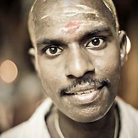 Hindu man after emerging from ceremony in Batu Caves, Kuala Lumpur