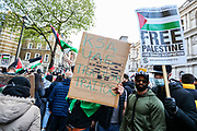 """London, United Kingdom, May 11, 2021: Pro-Palestinian people chant """"Free-Free Palestine"""" while they are holding banners and placards outside Downing Street during a """"Save Sheikh Jarrah"""" demonstration in central London on Tuesday, May 11, 2021. At least 24 Palestinians were killed last night in Israeli air raids on the besieged Gaza Strip. (Photo: Vudi Xhymshiti/VXP)"""