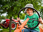 26 JUNE 2019 - CENTRAL CITY, IOWA: A child plays on an antique tractor at the Linn County Fair. Summer is county fair season in Iowa. Most of Iowa's 99 counties host their county fairs before the Iowa State Fair, August 8-18 this year. The Linn County Fair runs June 26 - 30. The first county fair in Linn County was in 1855. The fair provides opportunities for 4-H members, FFA members and the youth of Linn County to showcase their accomplishments and talents and provide activities, entertainment and learning opportunities to the diverse citizens of Linn County and guests.       <br /> PHOTO BY JACK KURTZ