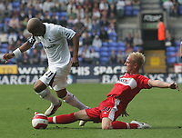 Photo: Andi Thompson.<br />Bolton Wanderers v Middlesbrough. The Barclays Premiership. 16/09/2006.<br />Bolton's El Hadji Diouf (L) goes past Boro's Andrew Davies.