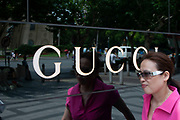 Gucci shop in the heart of Shanghais exclusive shopping district in Shanghai, China. Many of the Worlds major brands have arrived in China, and in particularly Chinas money capital, Shanghai. This part of Nanjing Rd is where the citys rich and famous come to shop.