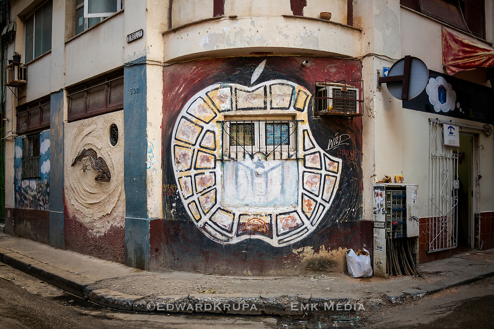 An artists interpretation of the Apple logo on a building in Havana.