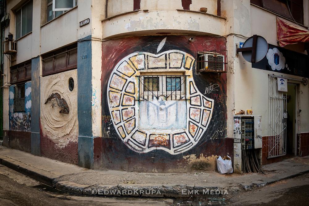 An artists interpretation of the Apple logo on a building in Havana.