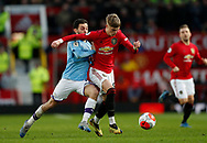 Brandon Williams of Manchester United tackled by Bernardo Silva of Manchester City during the Premier League match at Old Trafford, Manchester. Picture date: 8th March 2020. Picture credit should read: Darren Staples/Sportimage