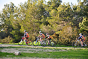 A group of leisure cross contry cyclists with protective clothing. Photographed at the Carmel Forest, Israel
