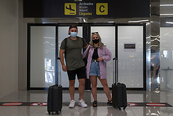 © Licensed to London News Pictures.  30/06/2021. Palma de Mallorca, Spain. Jess and Tom from Wales arrive at Palma Airport in Mallorca as Balearic Islands are on the UK 'green list' from 4am, today. Photo credit: Marcin Nowak/LNP
