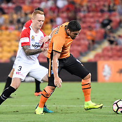 BRISBANE, AUSTRALIA - JANUARY 28: Dimitri Petratos of the Roar and Jack Clisby of the Wanderers compete for the ball during the round 17 Hyundai A-League match between the Brisbane Roar and Western Sydney Wanderers at Suncorp Stadium on January 28, 2017 in Brisbane, Australia. (Photo by Patrick Kearney/Brisbane Roar)