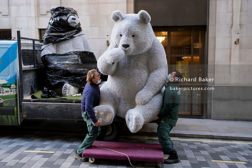 The first of two giant Christmas decoration bears are offloaded from a sub-contractor's lorry and delivered to the foyer of the Cafe Royal in Air Street, on 1st December 2020, in London, England. The bears have been manufactured by Romanian Eugeniu Dumneanu's Art-Grass company, a synthetic grass and turf provider specialising in the covering of surfaces and instillations with artificial grass and Astroturf.