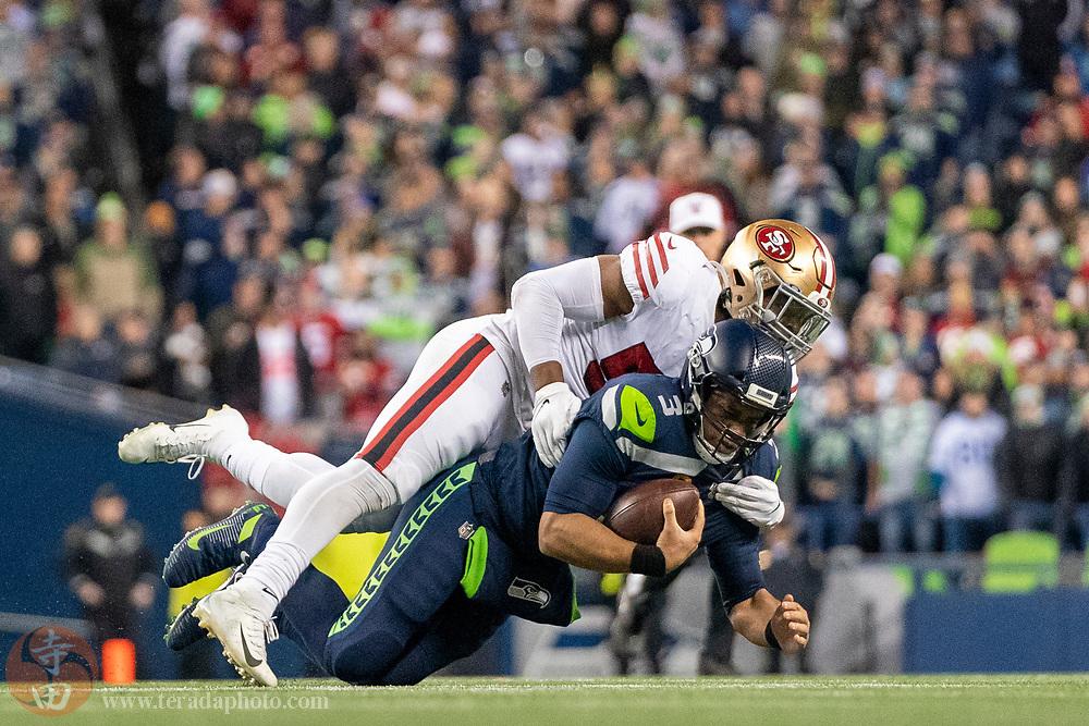 December 29, 2019; Seattle, Washington, USA; San Francisco 49ers linebacker Dre Greenlaw (57) sacks Seattle Seahawks quarterback Russell Wilson (3) during the fourth quarter at CenturyLink Field.