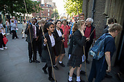 Beating Party made up of students from St Dunstans College, Catford, who return to their roots in the parish of St Dunstan-in-the-East to take part, together with the clergy and the Masters of our associated Livery Companies for Beating the Bounds on 25th May 2017 in London, United Kingdom. Beating the Bounds is an ancient custom still observed in many English parishes. Its roots go back to mediaeval times when parishes reaffirmed their boundaries by processing round them at Rogationtide, stopping to beat each boundary mark with wands and to pray for protection and blessings for the land. At All Hallows we beat the bounds of our parish every year on Ascension Day.