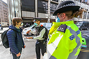 A police officer stopped and searched a press officer of Extinction Rebellion Youth Cambridge, who blocked the road outside Baringa Partners building in London on Thursday, Sept 10, 2020 - in an attempt to highlight the involvement of Schlumberger Limited in what they call 'ecocide'. Schlumberger is an oilfield services company working in more than 120 countries and has four principal executive offices located in Paris, Houston, London, and The Hague. An article at the Guardian suggests that it's ubiquitous in fossil fuel operations across the world, has more staff than Google, turns over more than Goldman Sachs, and is worth more than McDonald's – yet you won't have heard of it. XR Youth of Cambridge said that the British government gave 'Schlumberger' a no-strings-attached £150 million bailout loan as it was laying off a fifth of its global workforce. Another activist added: 'Schlumberger is hiding in plain sight here in Westminster. Every day, hundreds of people walk past this building with no idea that they're on the doorstep of a climate crime scene.'<br /> Environmental nonviolent activists group Extinction Rebellion enters its 10th and final day of continuous ten days protests to disrupt political institutions throughout peaceful actions swarming central London into a standoff, demanding that central government obeys and delivers Climate Emergency bill. (VXP Photo/ Vudi Xhymshiti)