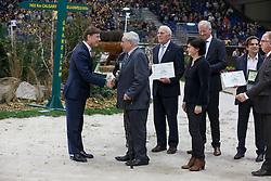 Willy Taets, (BEL) , breeder of Hello Sanctos (sBs), (Quasimodo vd Molendreef  - Nasia vd Gravenhof x Nabab de Rêve) with Dr Marc Pierson, president of SBS. Receiving a Rolex watch from Mr. Laurent Delonney, Directeur adjoint Sponsoring<br /> WBSFH Prizegiving<br /> Genève 2015<br /> © Hippo Foto - Dirk Caremans<br /> 12/12/15
