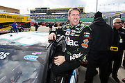 Carl Edwards reacts after his qualifying run for a NASCAR Sprint Cup Series race at Kansas Speedway, Friday, April 19, 2013 in Kansas City, Kansas. (AP Photo/Colin E. Braley)