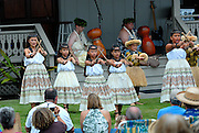 Children performing at the free monthly concert of traditional Hawaiian music and dance at the Hulihe'e Palace, in honour of Hawaiian royalty. Kailua-Kona, Big Island, Hawaii