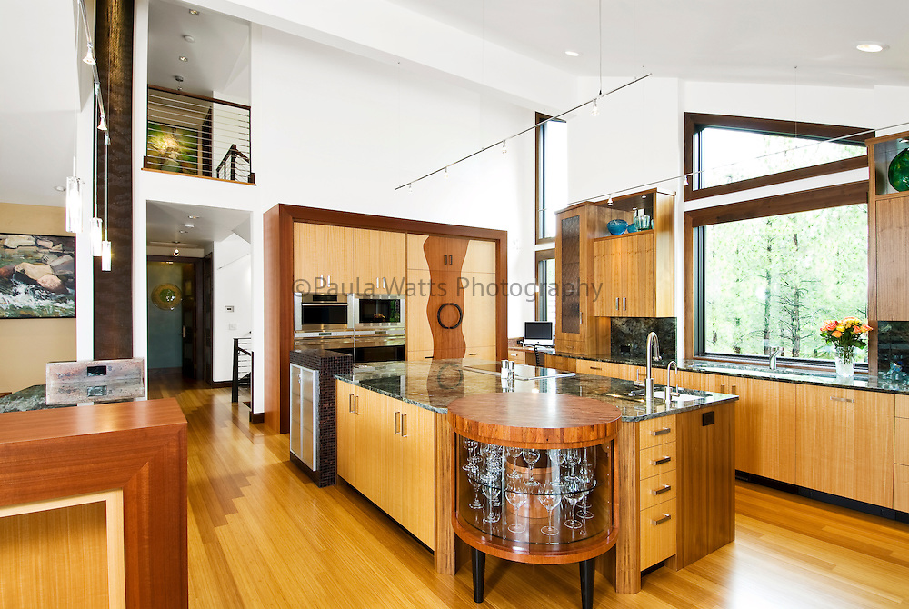 Contemporary large kitchen interior with custom cabinetry and waterfall features