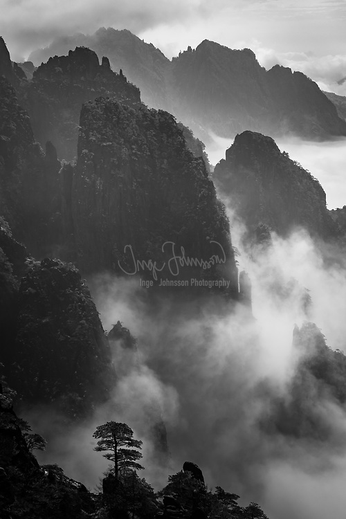 Huangshan (Chinese: 黄山, literal meaning: Yellow Mountain) is a mountain range in southern Anhui province in eastern China. Vegetation on the range is thickest below 1,100 meters (3,600 ft), with trees growing up to the treeline at 1,800 meters (5,900 ft).<br /> <br /> The area is well known for its scenery, sunsets, peculiarly-shaped granite peaks, Huangshan pine trees, hot springs, winter snow, and views of the clouds from above. Huangshan is a frequent subject of traditional Chinese paintings and literature, as well as modern photography. It is a UNESCO World Heritage Site, and one of China's major tourist destinations.