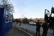 """Local Serbs, in Northern Mitrovica, open a Serbian Check point<br /> <br /> Northern Mitrovica, Kosovo<br /> Sunday, February 24, 2008<br /> <br /> Around 12/km far away from Southern Mitrovica, local Serbs from Zubin Potok suburban villages, 200metters near entrance of Qabre village populated with Albanians, put a barrack with close blue color, which means """"check point""""<br /> One of them, who doesn't preferred to tell his name says """"Here is going to be the border between Kosovo and Serbia, but what ever Kosovo is also Serbia, we will not let it go away of our hands""""<br /> On this point arrived many Danish KFOR soldiers, and situation become calm, Danish KFOR took that barrack and order Serbs to brake it away. According to some internal sources from the Serbian side, they're gone put it on next few 200metters away, from this point where they already put it today, and use to try and controlling civilian vehicles.<br /> PICTURED: Local Serbs during Danish KFOR was preparing to move them check point barrack, they use to burn grass, grass burned at the eye of KPS (Kosovo Police Service) members of Serbs nationality.<br /> Photographer VEDAT xhymshiti/ZUMApress"""