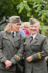 reenactors dressed as German army female signals auxiluaries (Nachrichtenheflrennin des heeres) also nicknamed Blitzmädchen or lightening girls because of the signals insignia on their uniforms, at Northallerton Wartime Weekend is a fund raising event that happens throughout the Yorkshire market town of Northallerton. .With help of volunteers and local business it has been successful in raising money for the charities.Help for Heroes.Royal British Legion.Bomber Command Memorial Charity .Ben Hyde Memorial Fund.<br />