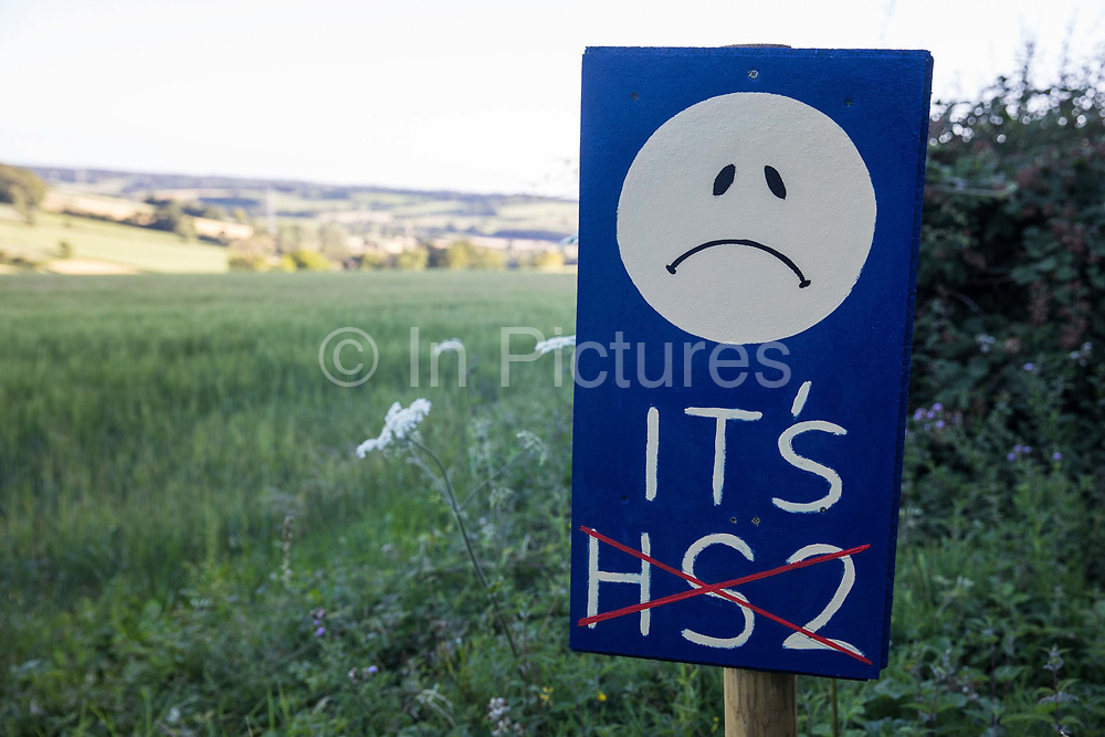 An anti-HS2 sign is displayed in front of a beautiful Chiltern countryside view on 17th July 2020 in Great Missenden, United Kingdom. Local residents and environmental activists continue to campaign against the high-speed rail link, primarily on the grounds of its impact on the environment and cost.