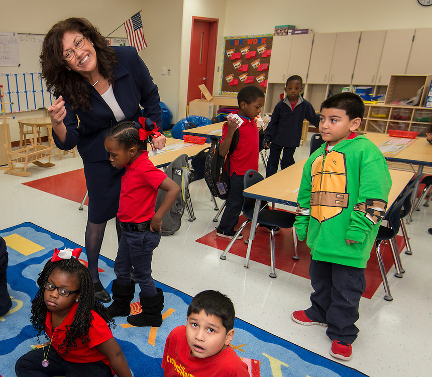 Principal Amelia Aguilar greets students on the first first day of class at the new Sherman Elementary School, December 2, 2013.