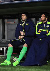 Arsenal goalkeeper Petr Cech (left) and Arsenal's Mohamed Elneny (right) in the dugout