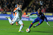 Swansea city's Alvaro Vazquez has a shot saved by  Valencia keeper Diego Alves. UEFA Europa league match, Swansea city v Valencia at the Liberty Stadium in Swansea on Thursday 28th November 2013. pic by Andrew Orchard, Andrew Orchard sports photography,